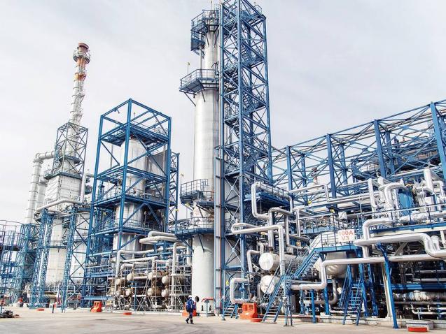 "OMSK, RUSSIA - OCTOBER 9, 2020: A view of the Omsk Oil Refinery, a subsidiary of Gazprom Neft, with installed capacity of over 22 million tonnes of oil per year. Dmitry Verkhorobin/Gazprom Neft/TASS  –осси€. ќмск. Ќа территории јќ ""√азпромнефть-ќмский Ќѕ«"". јќ ""√азпромнефть-ќЌѕ«"" - дочернее предпри€тие ѕјќ ""√азпром нефть"". ""становленна€ мощность превышает 22 млн тонн нефти в год. ƒмитрий ¬ерхоробин/√азпром Ќефть/""ј——"