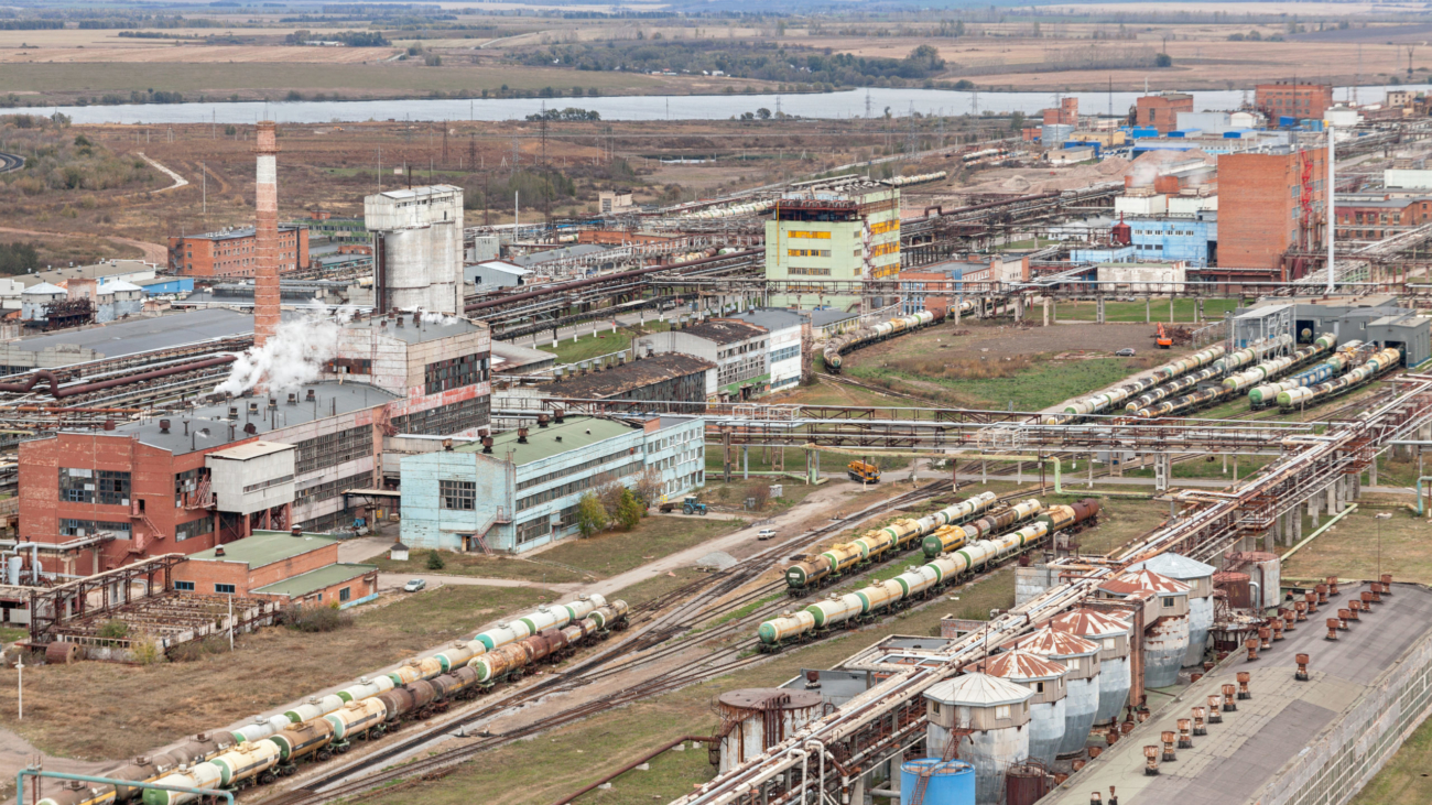 Chemical plant for production of acids and ammonia. Top view. The railroad with freight trains