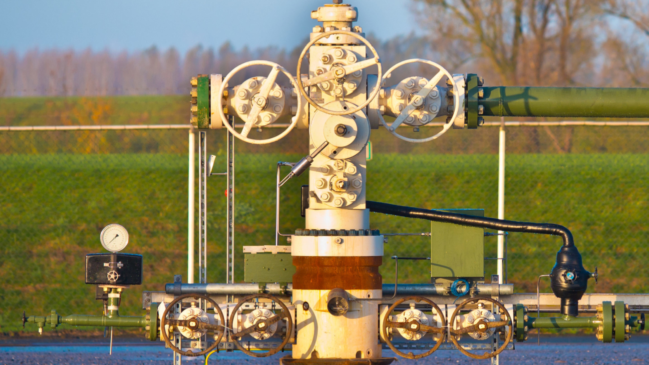 Vintage natural gas well head in the early morning in Grijpskerk, Netherlands