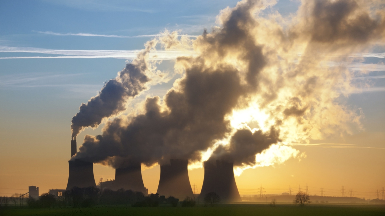 Late afternoon sun through the steam from the cooling towers of a Power Station in Leicestershire in the United Kingdom.
