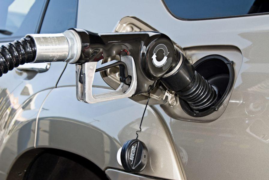 A gasoline pump fills a car with premium fuel.