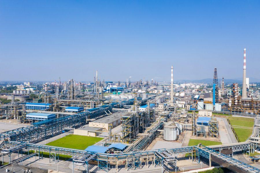 modern petrochemical oil refinery against a blue sky