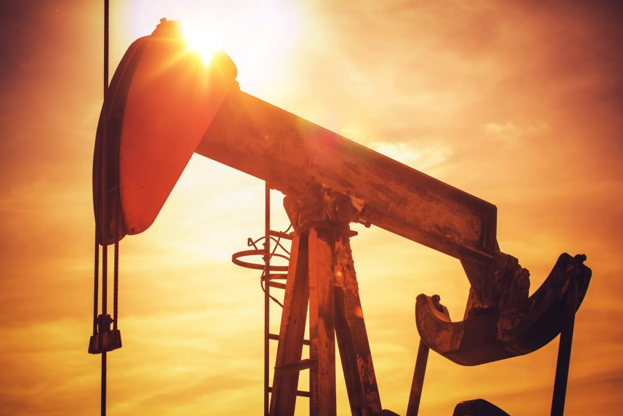 Oil Pump on California Prairie. Scenic Industrial Sunset. Oil Industry Theme with Pumping Unit.