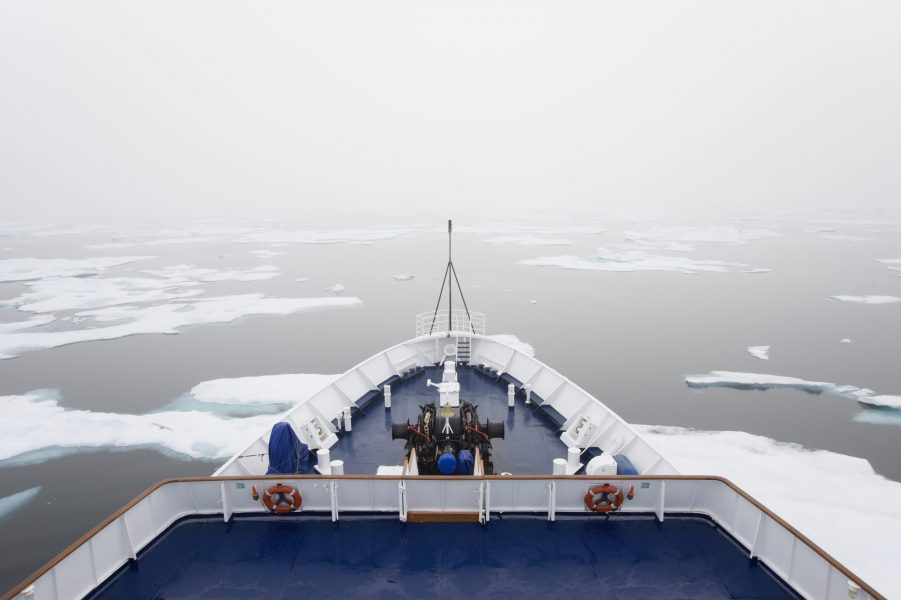 The view over the decks of a cruise ship in the Canadian Arctic region, moving through ice floes.